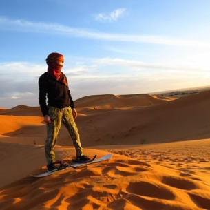 Sandboarding in Merzouga dunes - Erg Chebbi desert activities